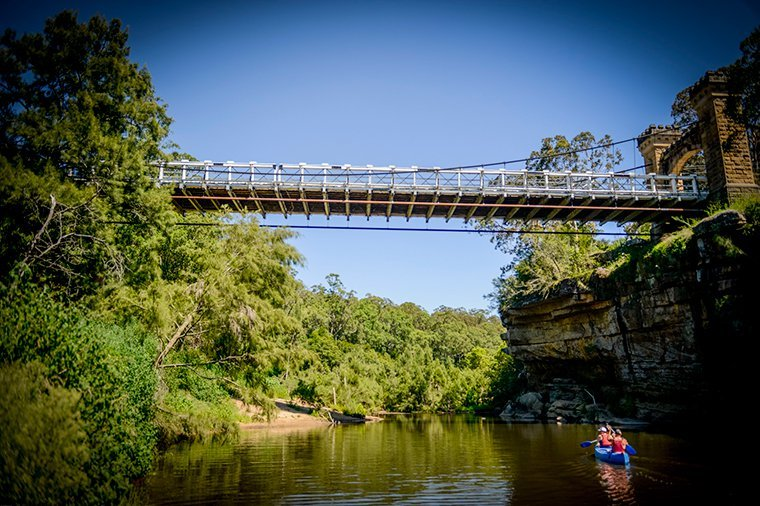 Kayaking under Hampden Bridge, Kangaroo River Valley, NSW.